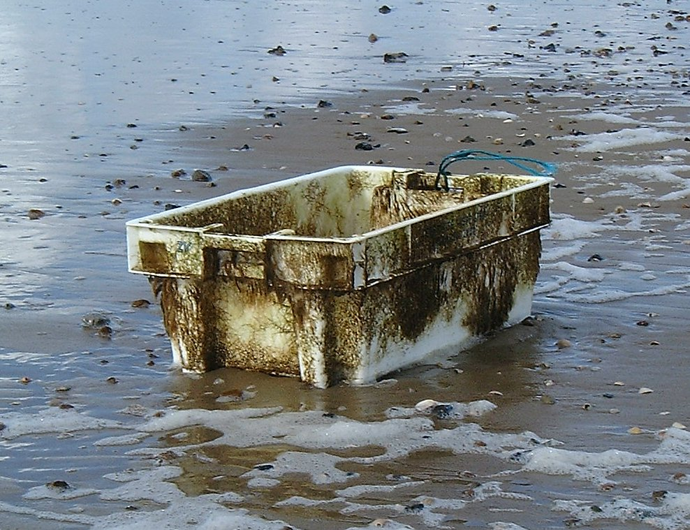 A plastic box washed up on a beach