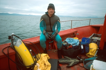 Marine engineer and underwater photographer Klaus Jost preparing to dive