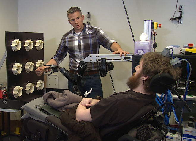 Dr Robert Gaunt, from the University of Pittsburgh, with Nathan Copeland, who sustained a spinal injury ten years ago and now has received a brain implant enabling him to experience \sensations\ with this hand.