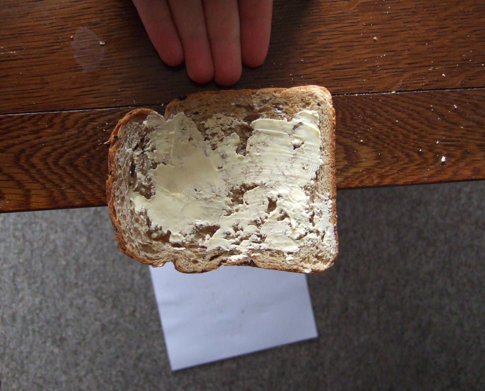 Pushing toast of table