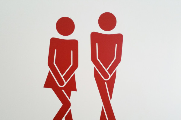 male and female stick people needing the toilet