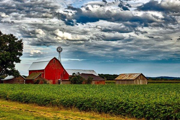 A red barn in a farmer's field