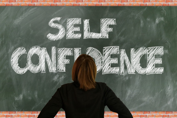 Self confidence written on a blackboard