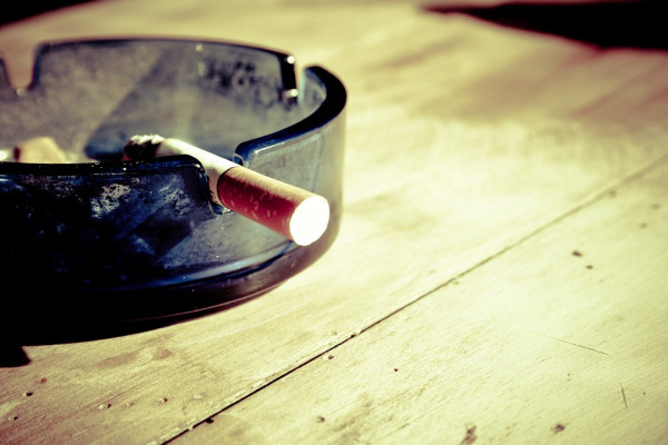 Cigarette in ash tray.