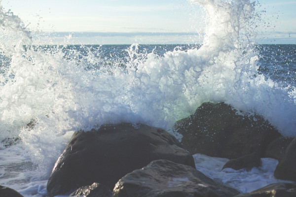 This is a picture of waves splashing against rocks.