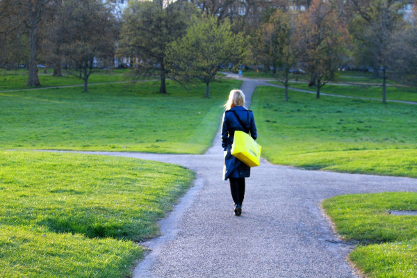 woman approaching a crossroads