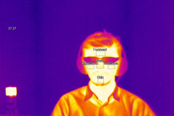 Thermal camera image of a person wearing glasses.
