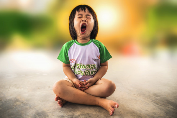 girl yawning whilst seated