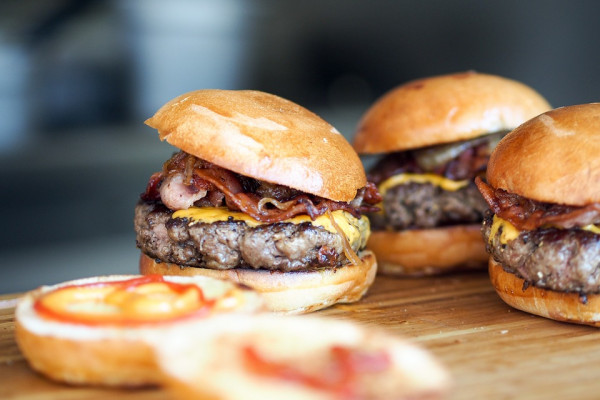 A few burgers on a table