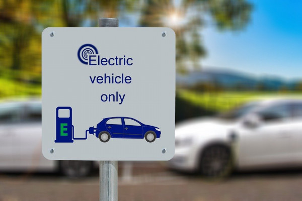 A sign for an electric vehicle charging station.