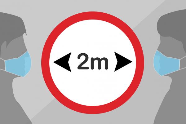 Sign indicating people should keep 2 metres apart.