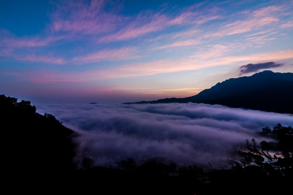 A view of low clouds and mountain ranges in China's Yunnan province.