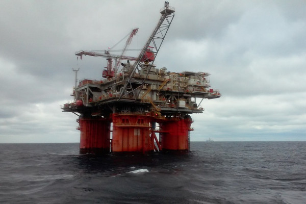 An oil rig in the ocean.