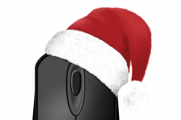 A computer mouse with a santa hat on