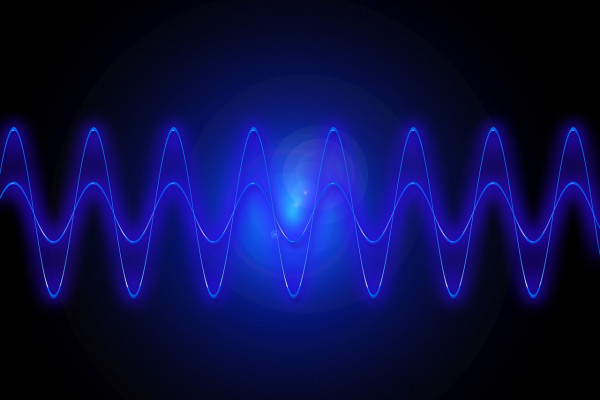 Two blue sign waves superimposed on top of one another