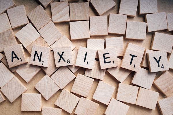 The word 'anxiety' spelled out in scrabble tiles.