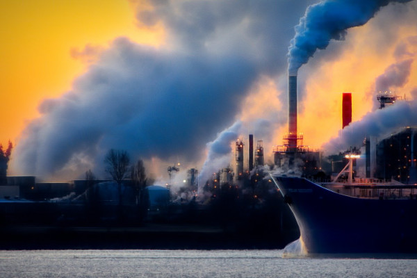 Smoke emissions and air pollution from an industrial landscape.