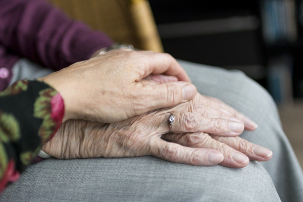 The hands of an elderly couple.
