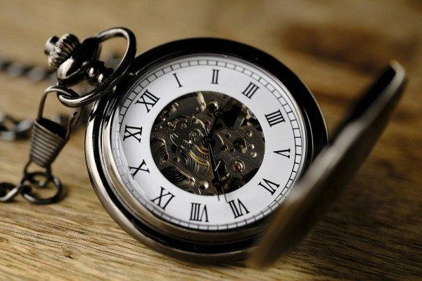 A close up of an open pocket watch