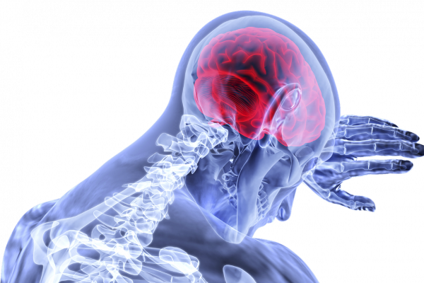 A X-ray image of figure clutching their head, with their brain glowing in red.