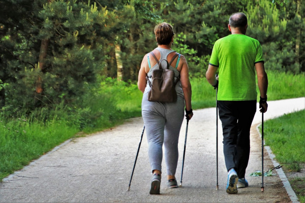 Two people walking with hiking poles