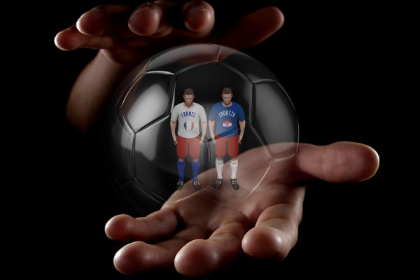 Foutball players in a see-through ball