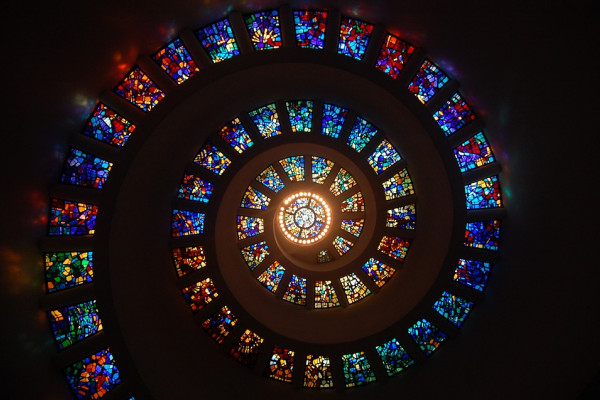 A spiral made of different stained glass windows