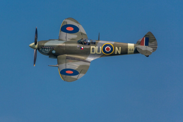 A spitfire aeroplane, flying through the air