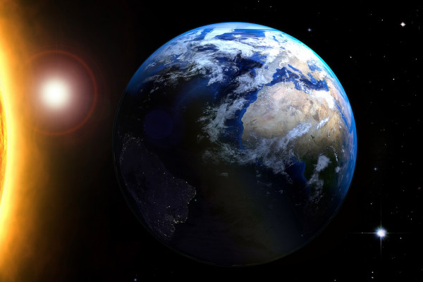 The Earth in space orbiting round the sun.