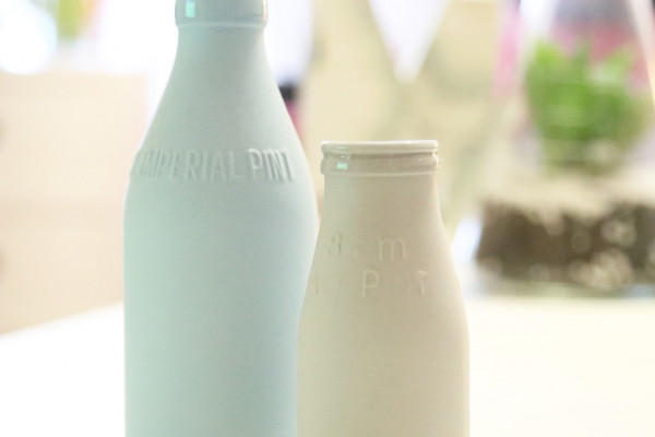 Two dairy bottles.