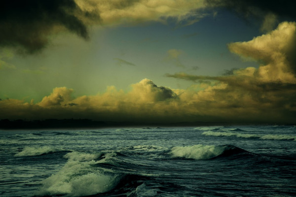 Looking out to sea, dark clouds on the horizon