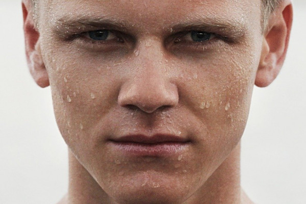 A man sweating on his face