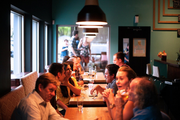 People conversing in a bar