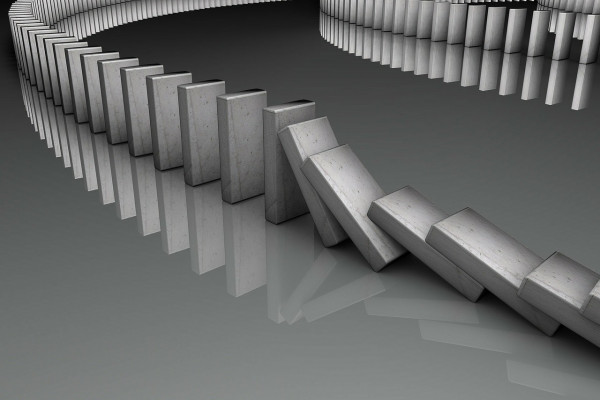 A line of dominoes falling in succession