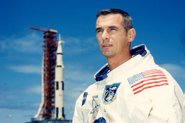 Astronaut Gene Cernan in front of a rocket