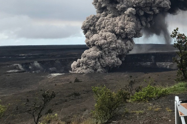 Ash column rises from the Overlook crater at the summit of Kīlauea Volcano. HVO's interpretation is that the explosion was triggered by a rockfall from the steep walls of Overlook crater. The photograph was taken at 8:29 a.m. HST on the 10th May from the