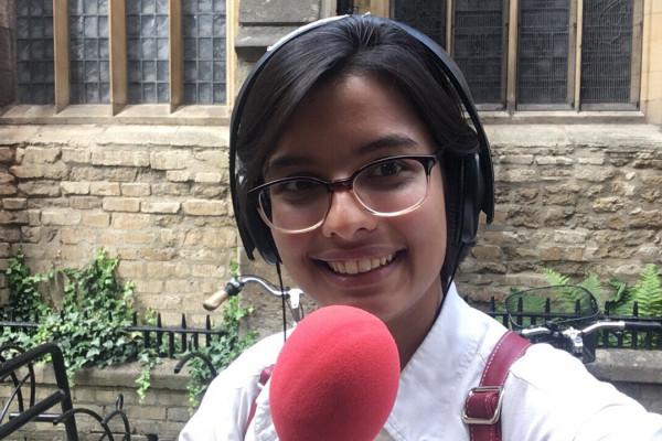 Ankita holding a mic