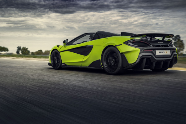 Lime-green McLaren 600LT Spider driving on road