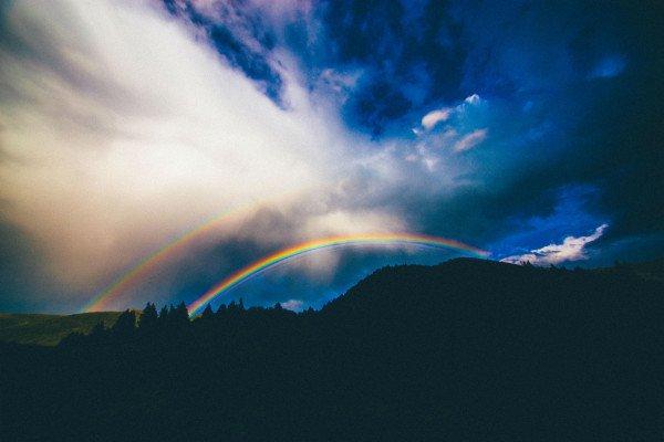 Double rainbow over mountains