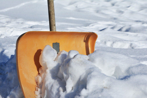A snow shovel half-buried in snow.