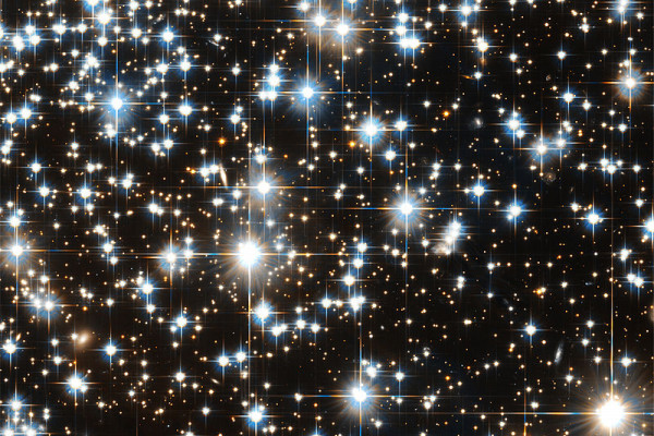 Hubble Telescope image of distant stars showing diffraction artefacts.