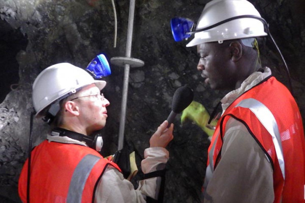 Chris Smith speaks to miners and geologists deep underground at the driefontein mine in South Africa