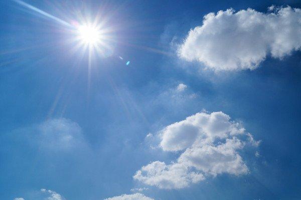 Bright sun in a blue sky