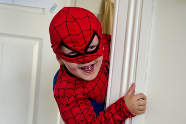 Boy dressed in a spiderman costume