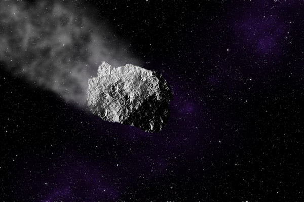 An asteroid flying through space