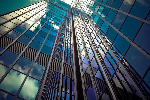 a view of a glass skyscraper shot from ground level
