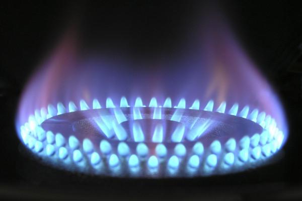 A Close up of a lit gas burner cooker