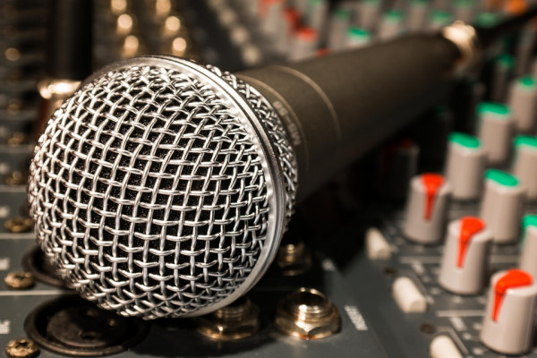 A microphone and mixing desk