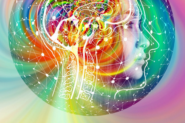 A brain surrounded by vivid colours.
