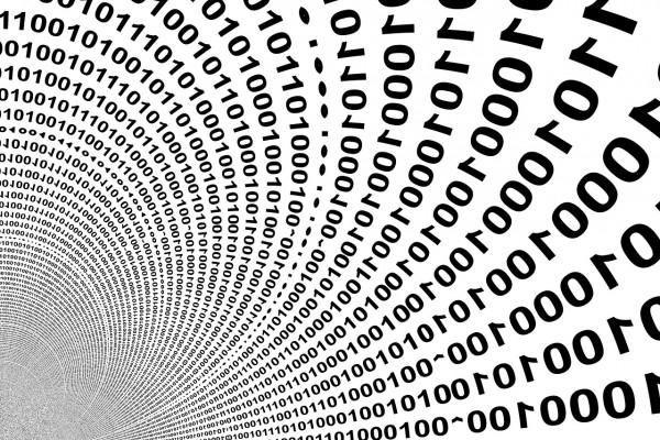 Binary digits spiralling away to infinity.
